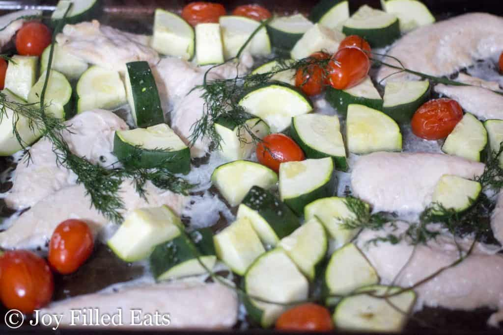 Greek chicken on a sheet pan with vegetables