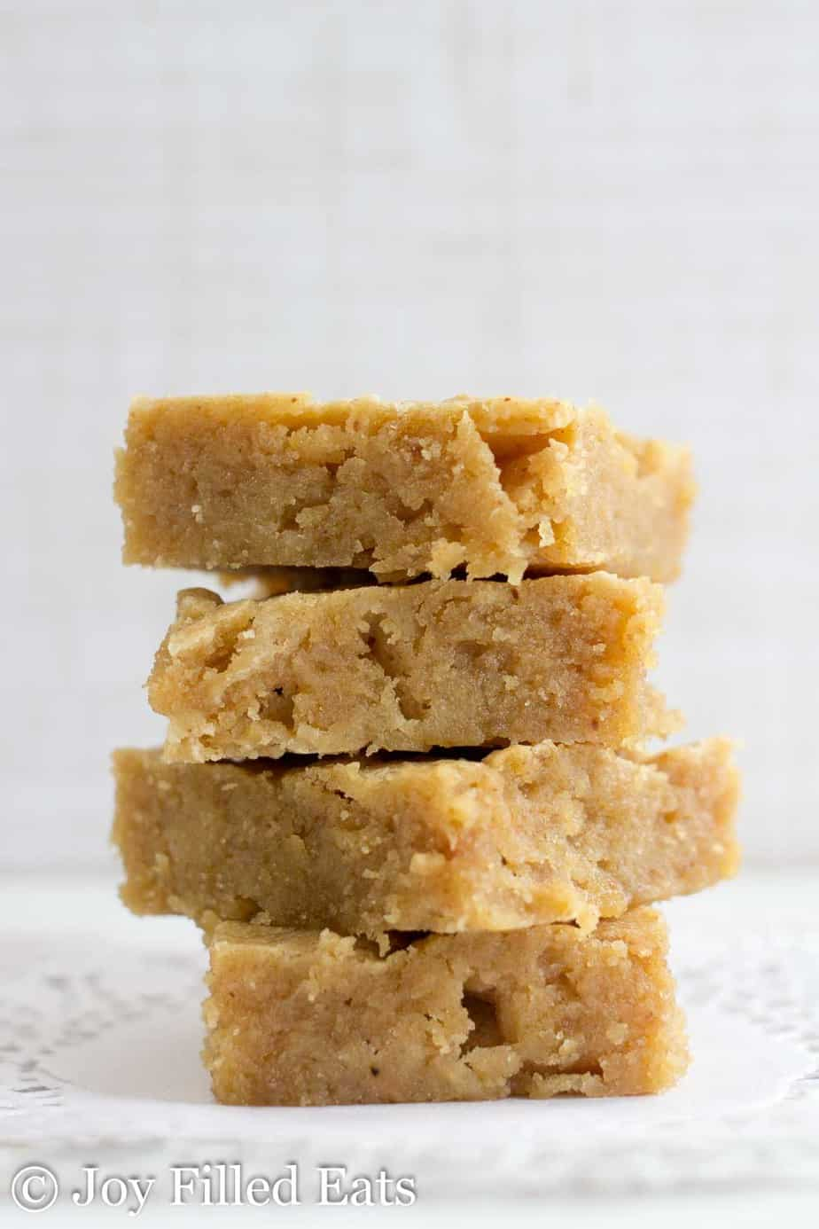 close up on stack of white chocolate peanut butter blondies