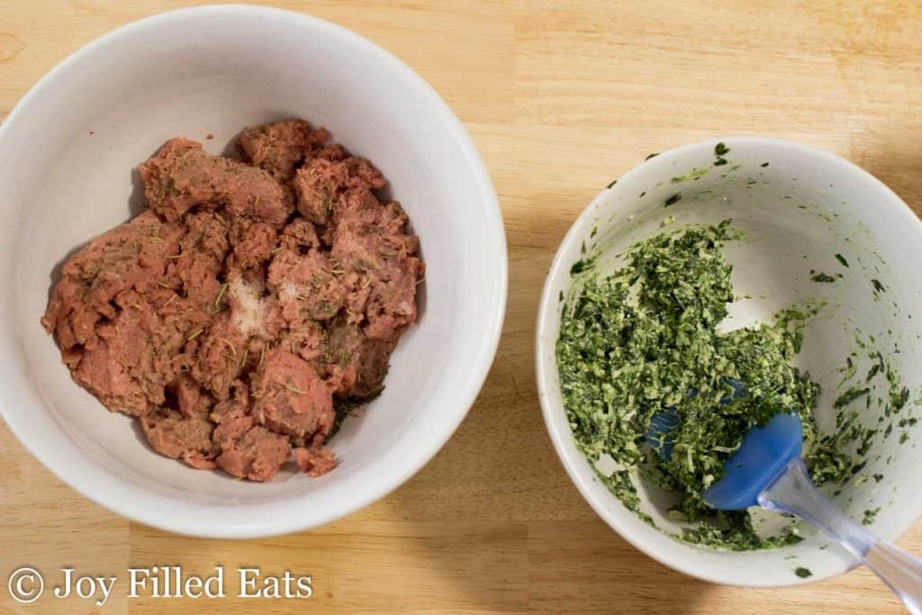 seasoned ground turkey meat in a large bowl next to a bowl of spinach and three cheese filling with spatula