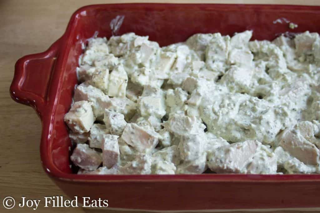 The Easy Mozzarella & Pesto Chicken Casserole waiting to be topped with cheese and baked.