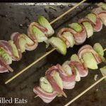 sheet pan lined with bacon & Brussels sprout kebabs before baking
