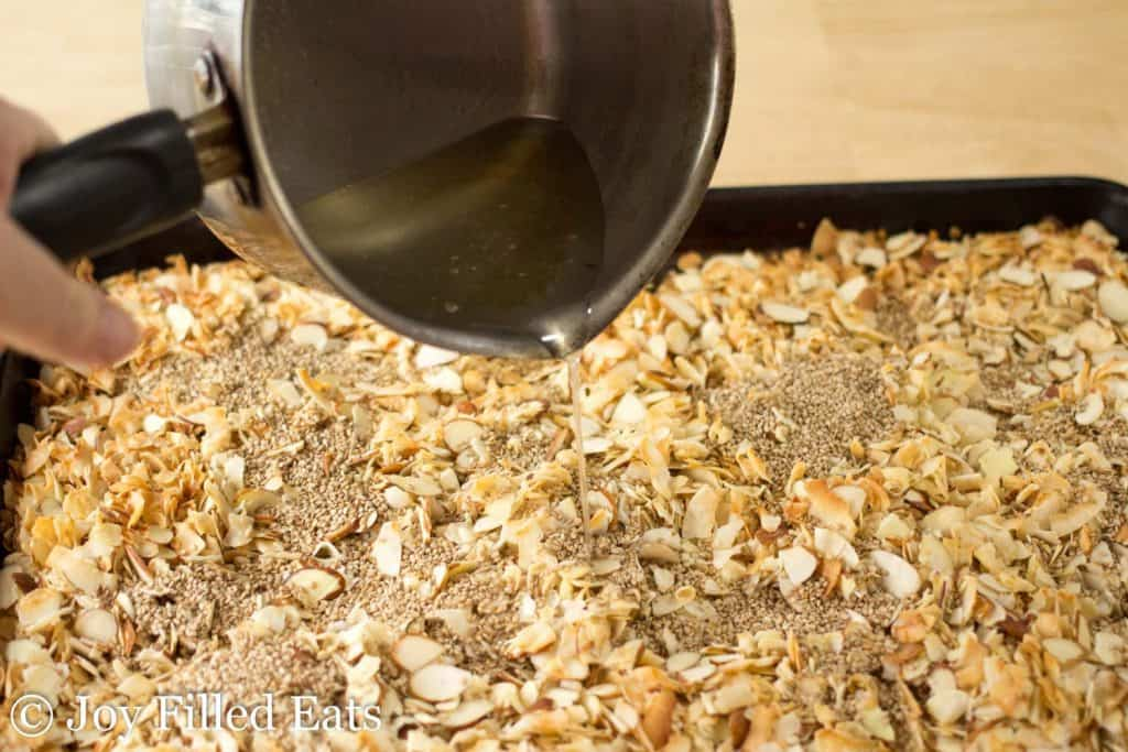Pouring the syup over the low carb granola