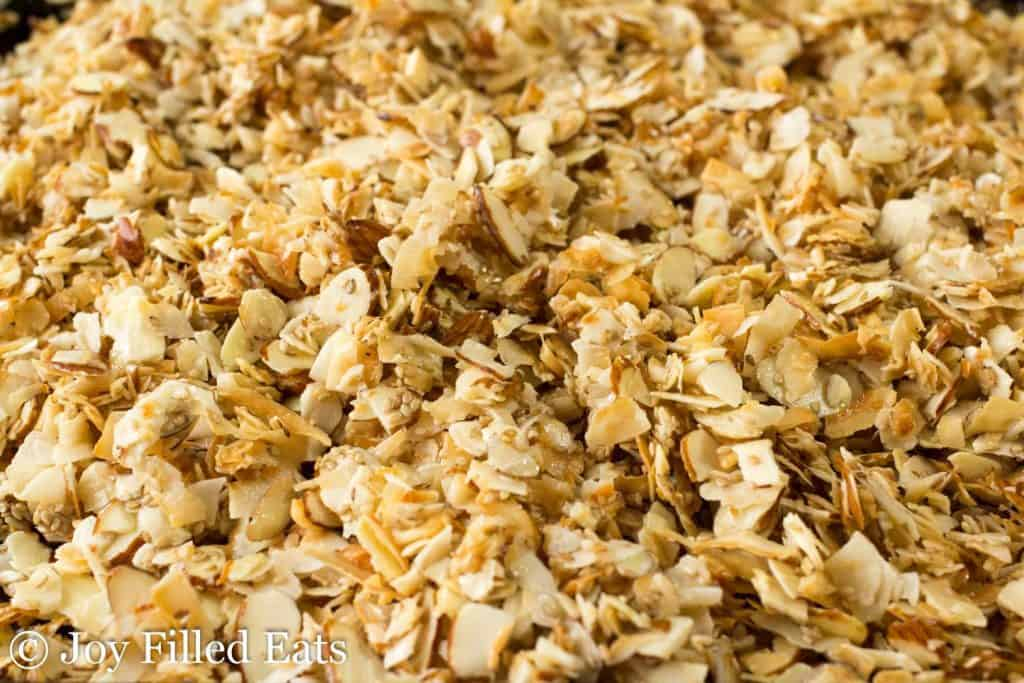 close up on almond coconut sesame seed granola laying flat