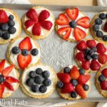 mixed mini fruit pizza cookies arranged on a tray