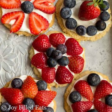 overhead view of a variety of mini fruit pizza cookies