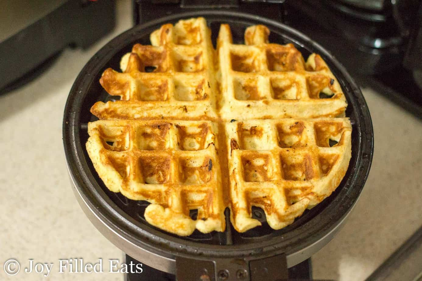 almond flour vanilla waffles in a waffle maker