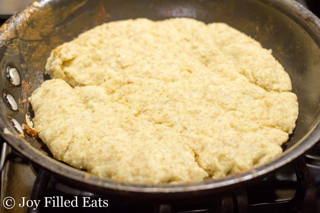 skillet lined with cooking low carb pizza dough for low carb skillet pizza