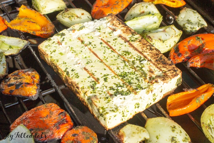 Grilling paneer cheese and veggies on a grill outside