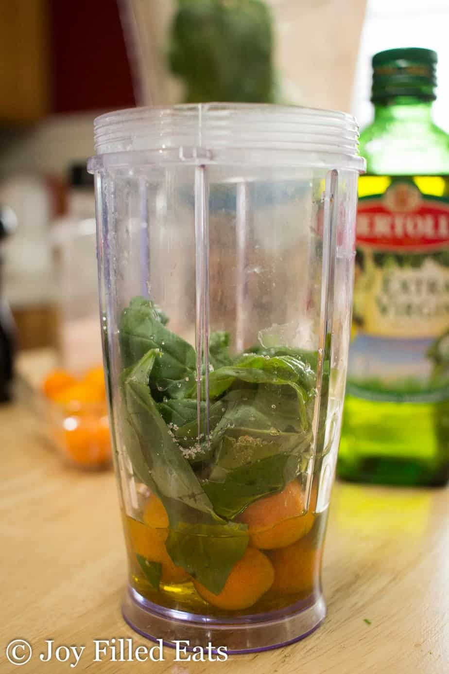 ingredients for citrus basil dressing in a small blender container