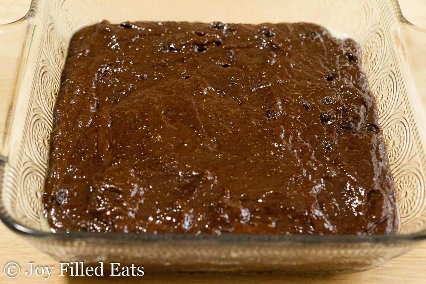 chocolate brownie batter spread into baking dish