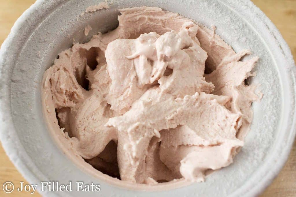 Homemade Strawberry Ice Cream in the ice cream maker bowl