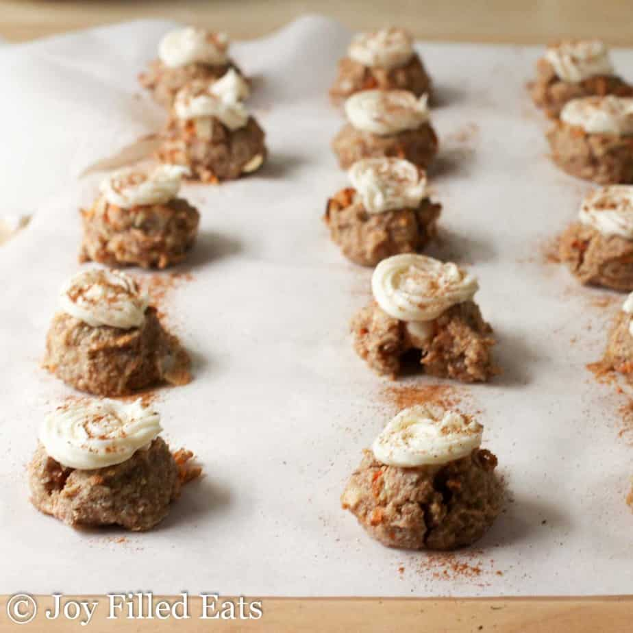 Mini Carrot Cake Cookie Bites lined up on parchment paper