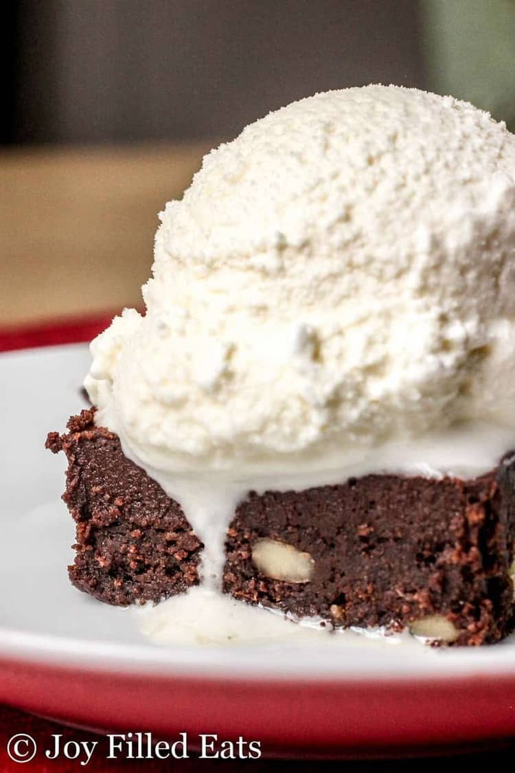 Close up of a homemade vanilla ice cream topped brownie