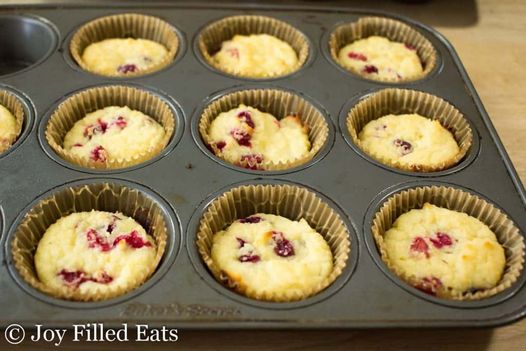 muffin tin filled with Cranberry Orange Muffins