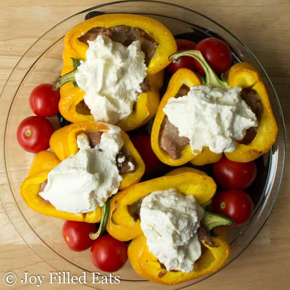 White Lasagna Stuffed Peppers topped with ricotta