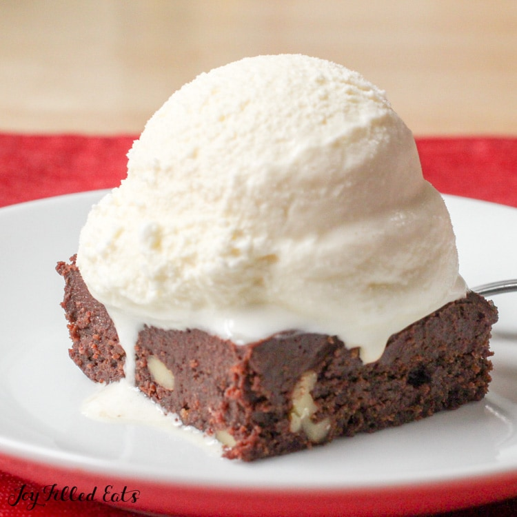 brownie topped with keto vanilla ice cream on a plate