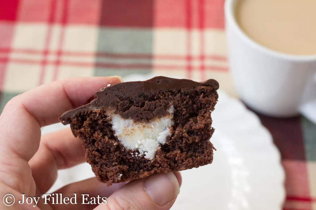 hand holding a dark chocolate peppermint cupcake cut in half