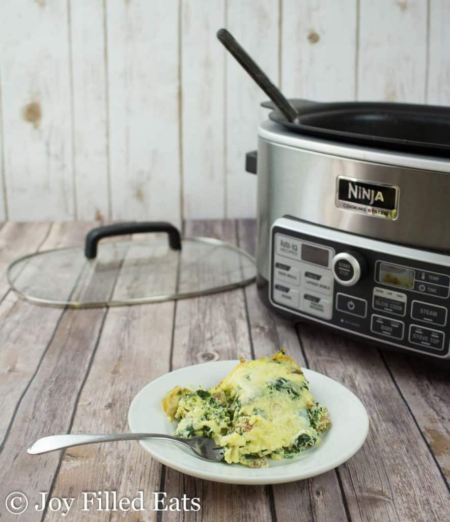 close up on plate with Bacon Swiss Frittata serving next to a Ninja cooking system