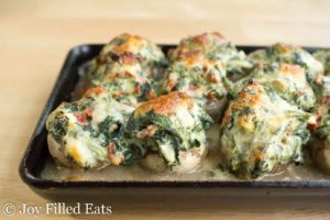 baking sheet lined with Tuscan stuffed mushrooms
