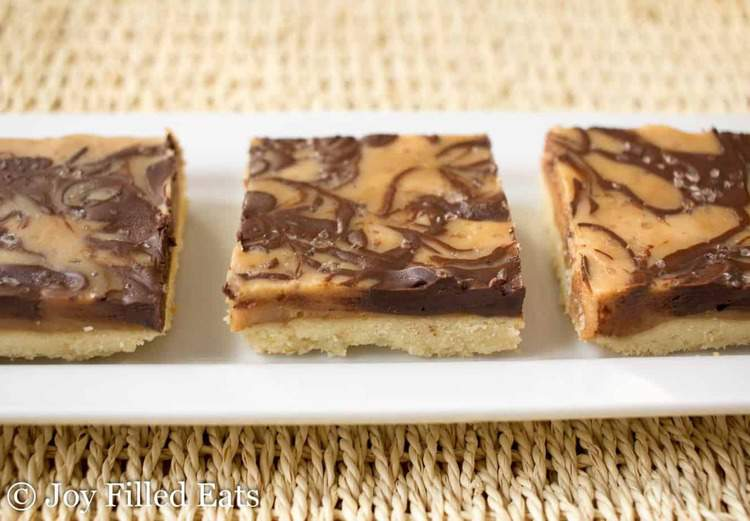 salted caramel shortbread squares lined on a platter