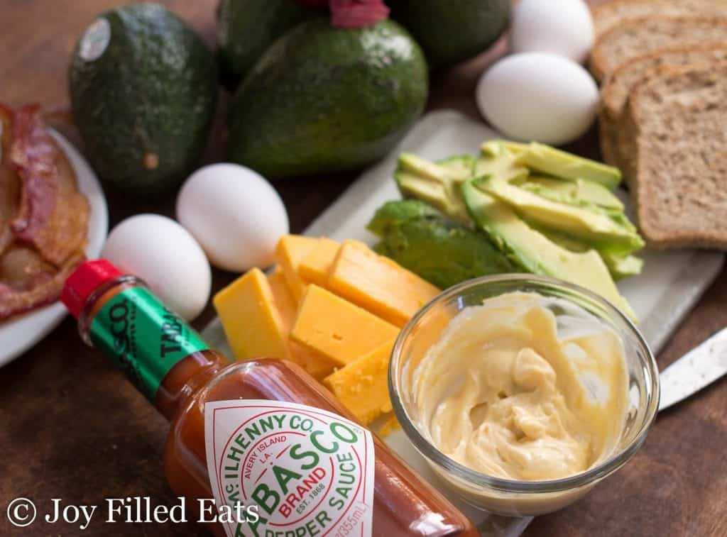 overhead view of ingredients for loaded egg sandwich