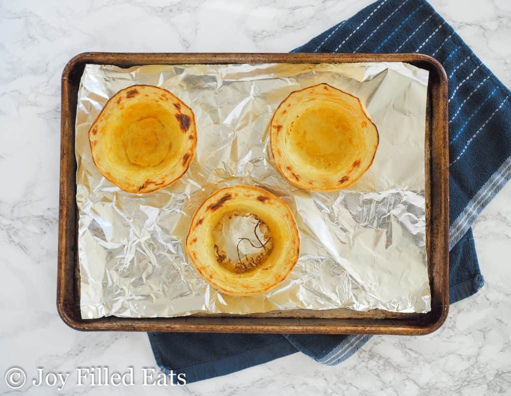 rings of baked spaghetti squash on a baking pan