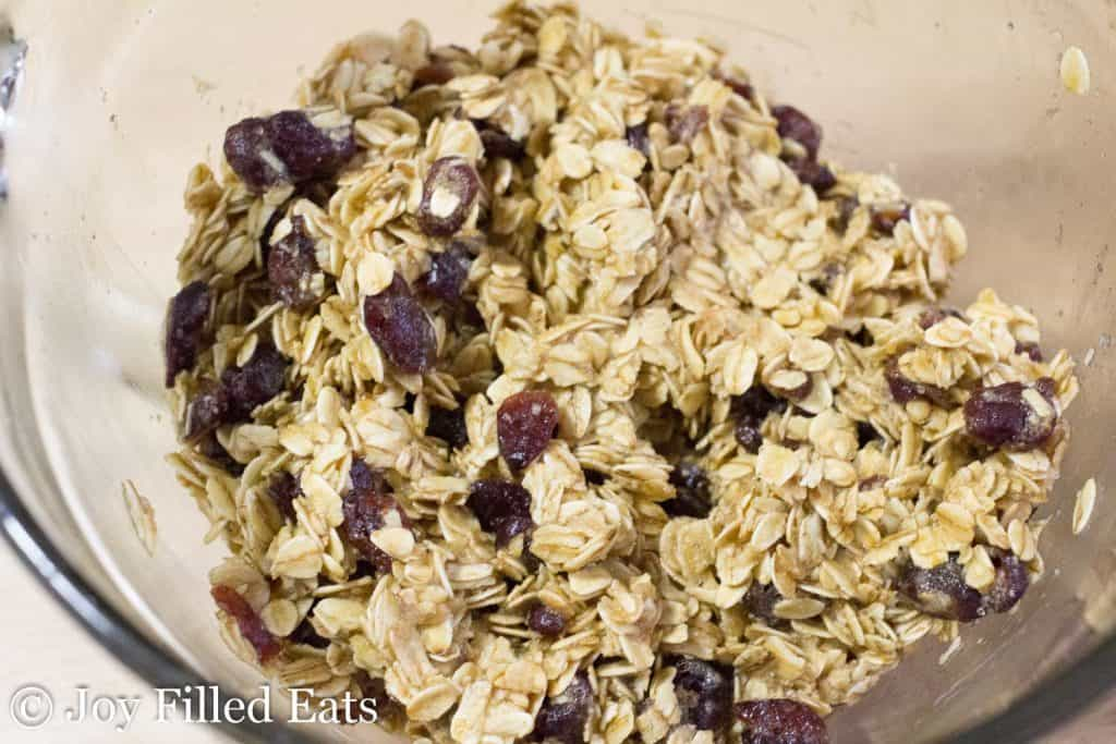 healthy granola ingredients combined in mixing bowl