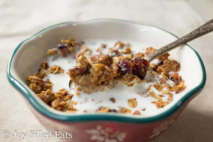 bowl of granola and type of milk with spoon