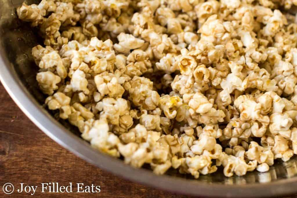 A stainless steel bowl with salted caramel popcorn.
