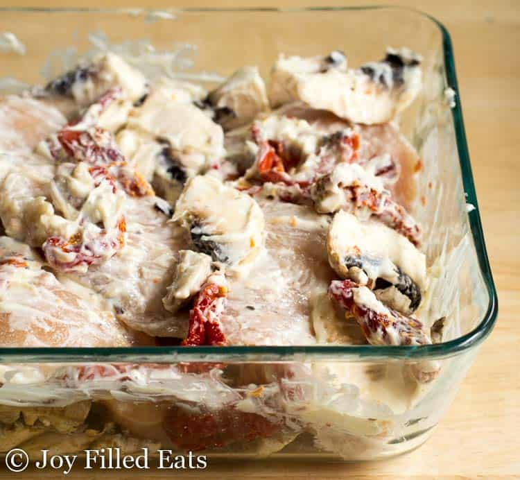creamy baked chicken breast in a glass dish