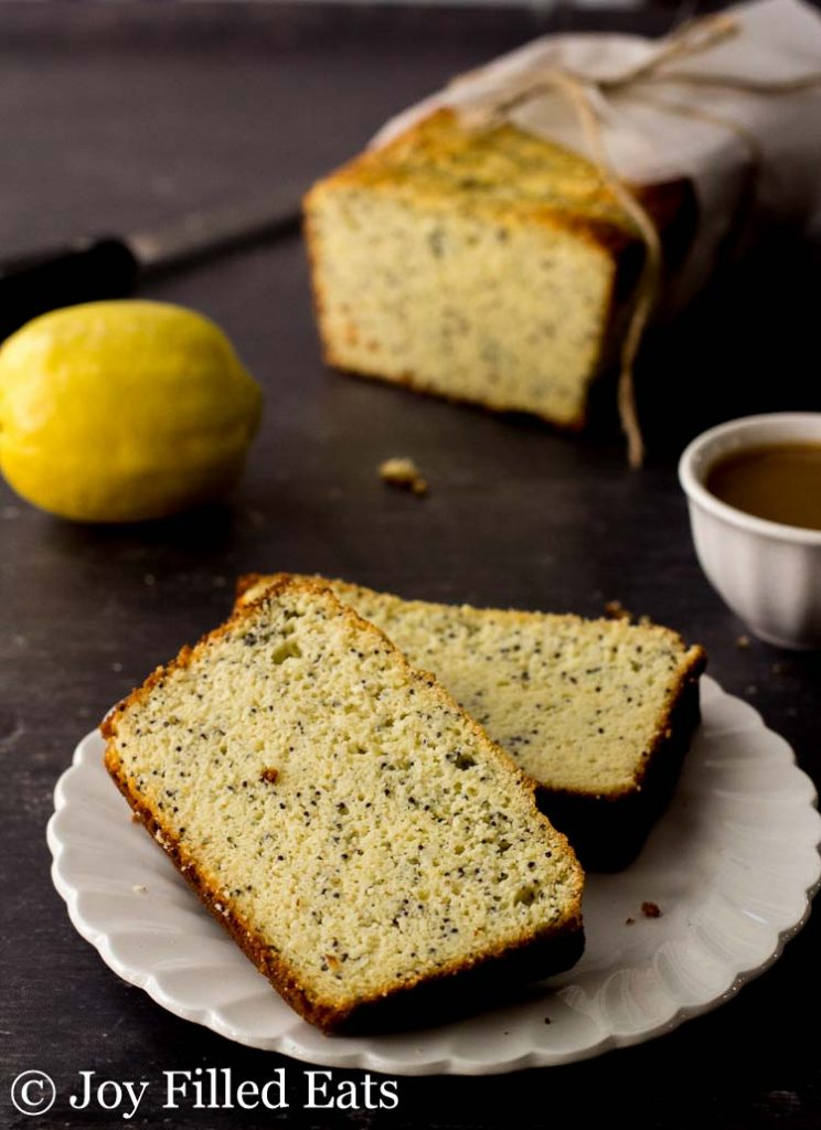 Lemon Poppy Seed Loaf Cake slices on a white plate