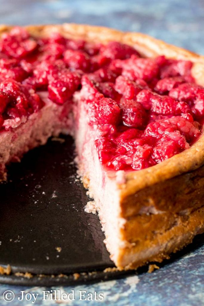Raspberry Cheesecake recipe with a slice missing