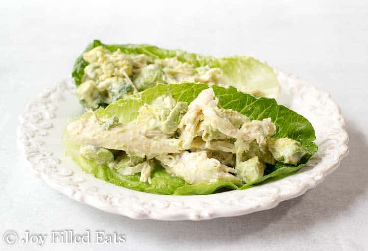 Chicken salad with avocado in lettuce leaves
