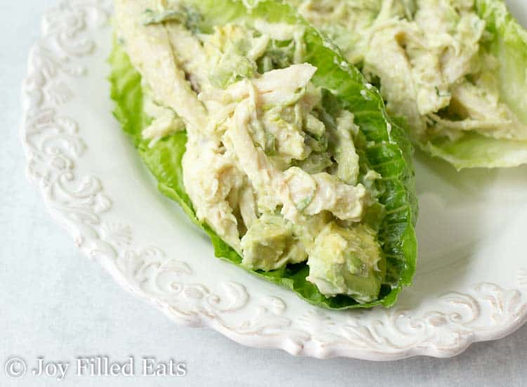 Close up of the chicken salad lettuce wraps on a decorative white plate