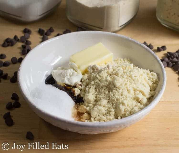 A white bowl with the ingredients for the cookie dough bites