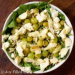 overhead view of spinach salad with grilled grapes and brie cheese