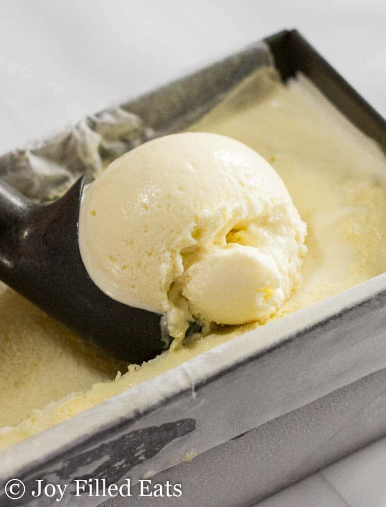 Pina colada ice cream being scooped with an ice cream scoop