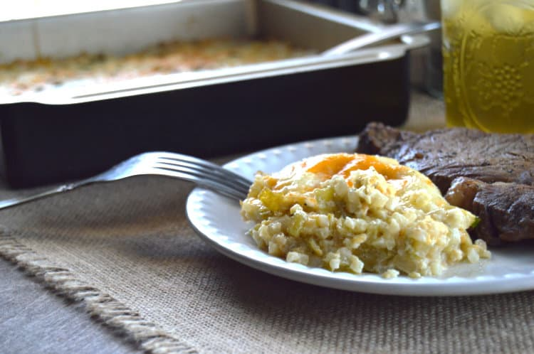 Green Chile Cauliflower Casserole on a plate next to a steak