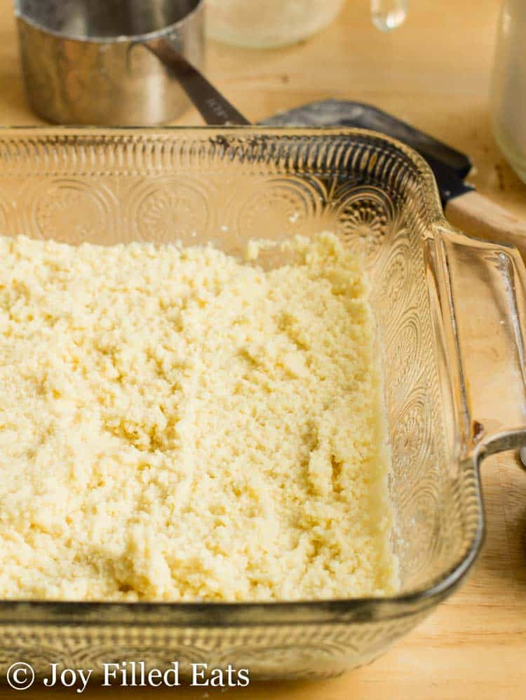 white chocolate blondies batter layered at the bottom of a casserole dish