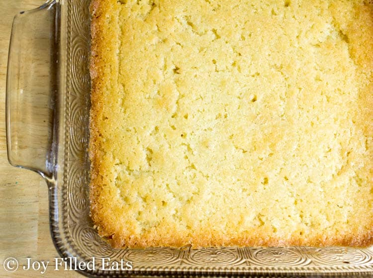 white chocolate blondies in a casserole dish before being cut into squares
