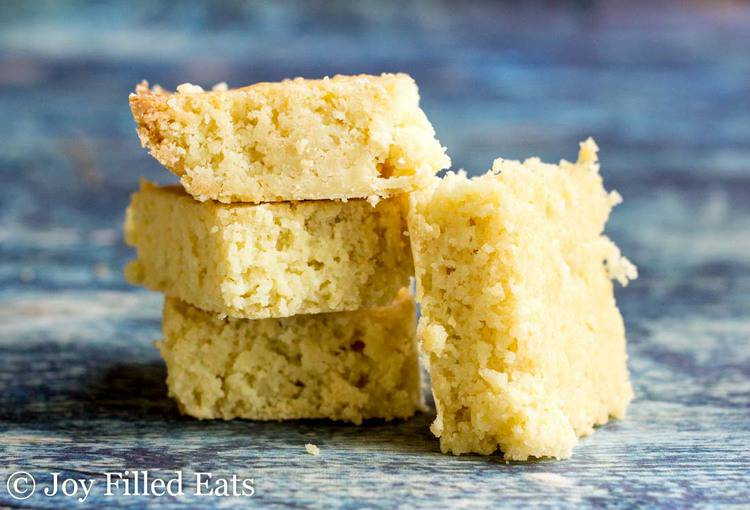 stack of white chocolate blondies with one blondie leaning on the stack