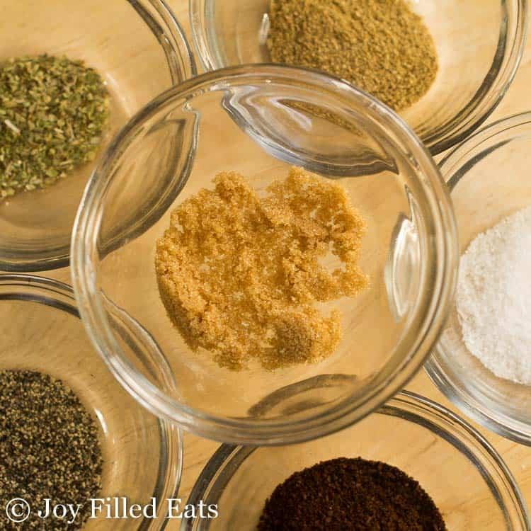 individual ingredients for dry rub in separate small bowls