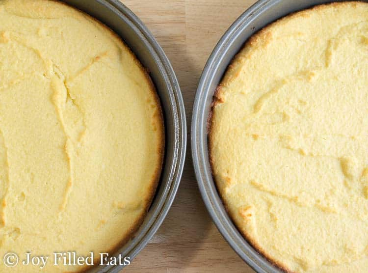 two banana cakes in cake pans from above