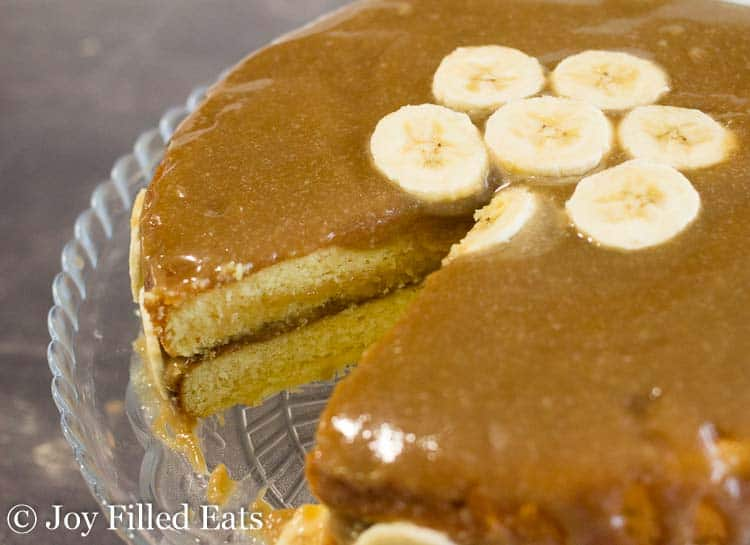 close up of the Easy Banana Cake Recipe with Caramel Frosting with banana slices on top