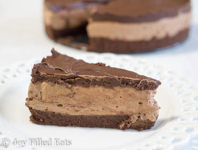Slice of No Bake Chocolate Brownie Batter Cheesecake on a white plate