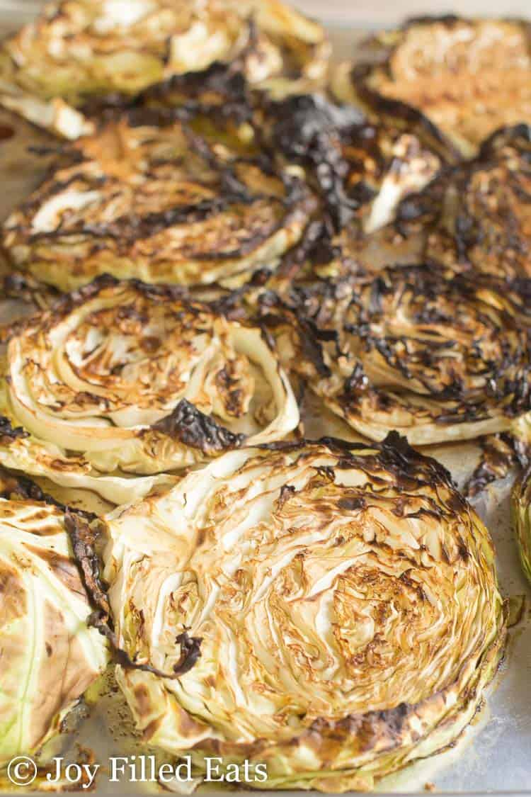roasted cabbage steaks with balsamic lined on a sheet pan