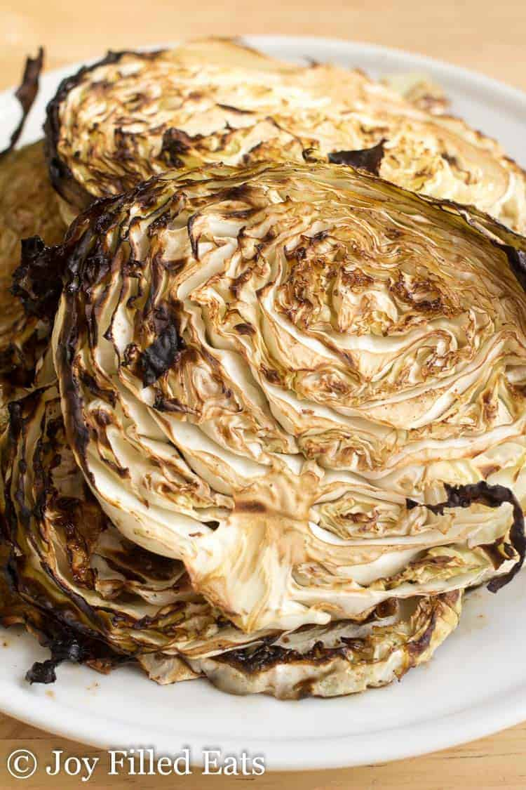 close up on roasted cabbage steaks with balsamic