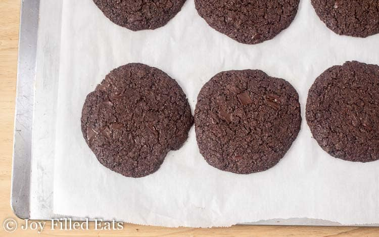 chocolate cookies lined on a parchment lined sheet pan from above