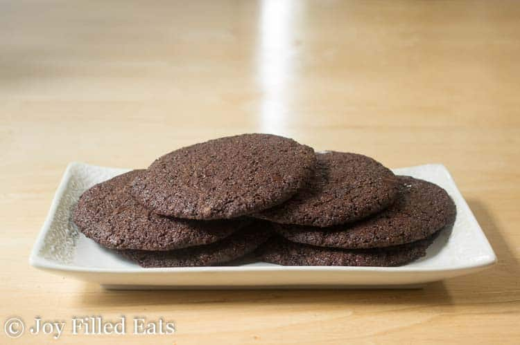 pile of triple chocolate cookies on a white plate