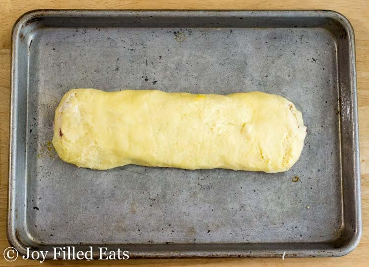 The unbaked chicken stromboli on a baking sheet